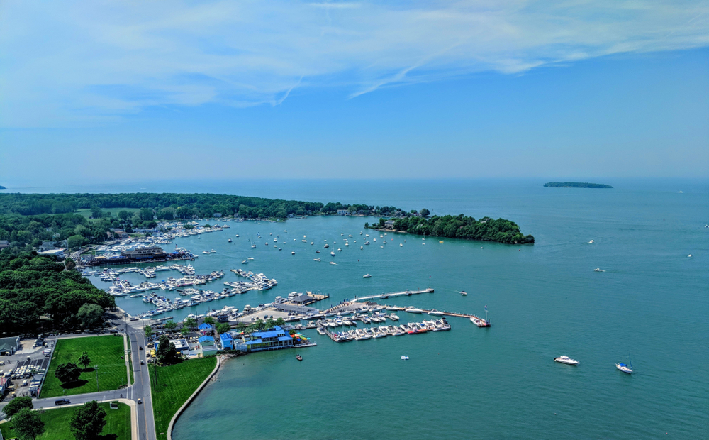 Aerial view of South Bass Island State park, with marina and deep blue-green Lake Erie waters.