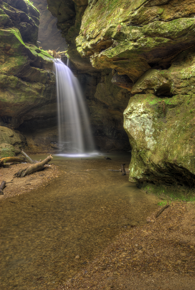 waterfall surrounded by mossy rocks flowing into small pool best hikes in Ohio