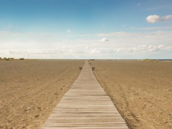 Boardwalk leading out to Lake Erie through sandy beach in Ohio