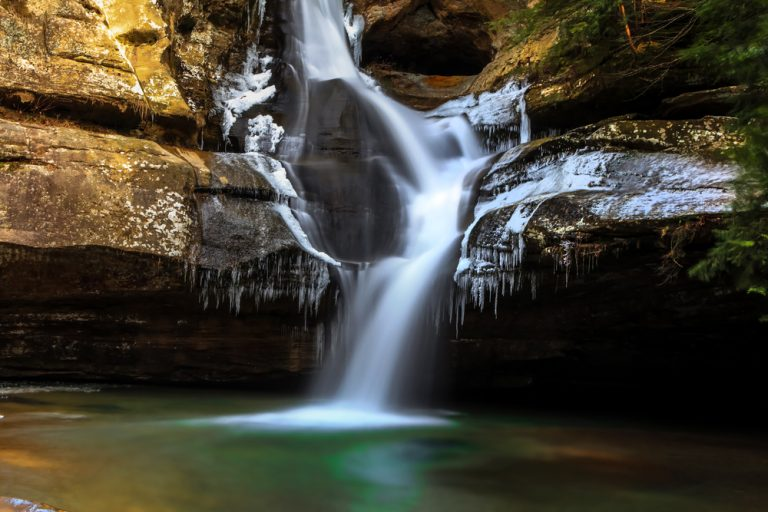 small waterfall flowing into turquoise pool best hikes in Ohio