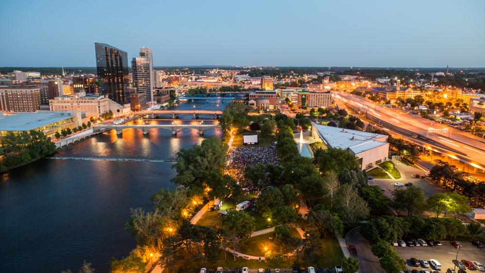 Ariel view of Grand Rapids, a Chicago day trip, illuminated at sunset.