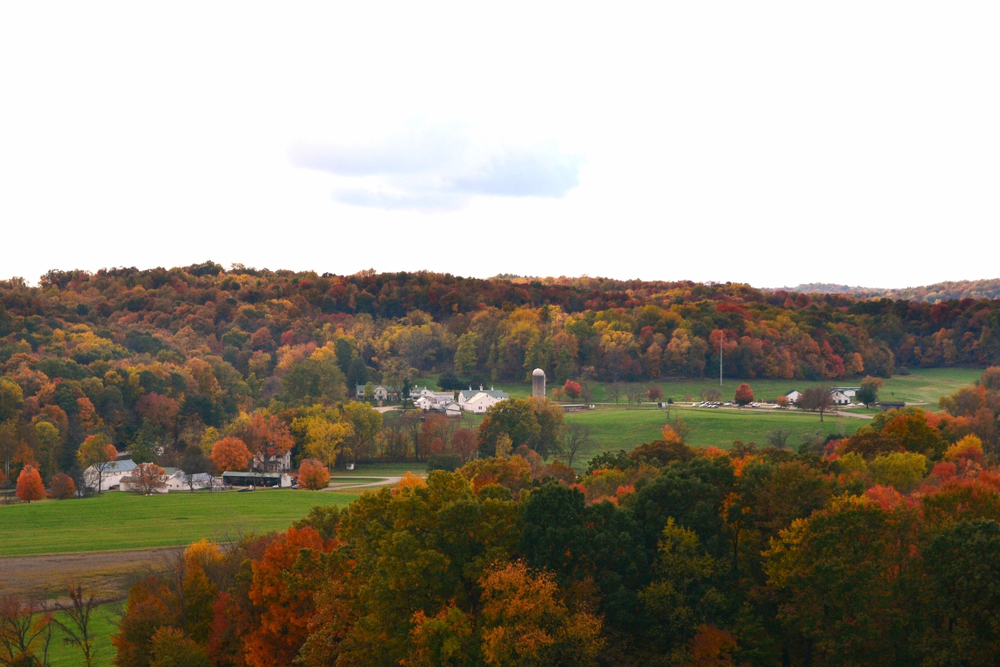 Photo of Malabar farm one of the haunted places in Ohio, nestled between trees with bright autunm colors.