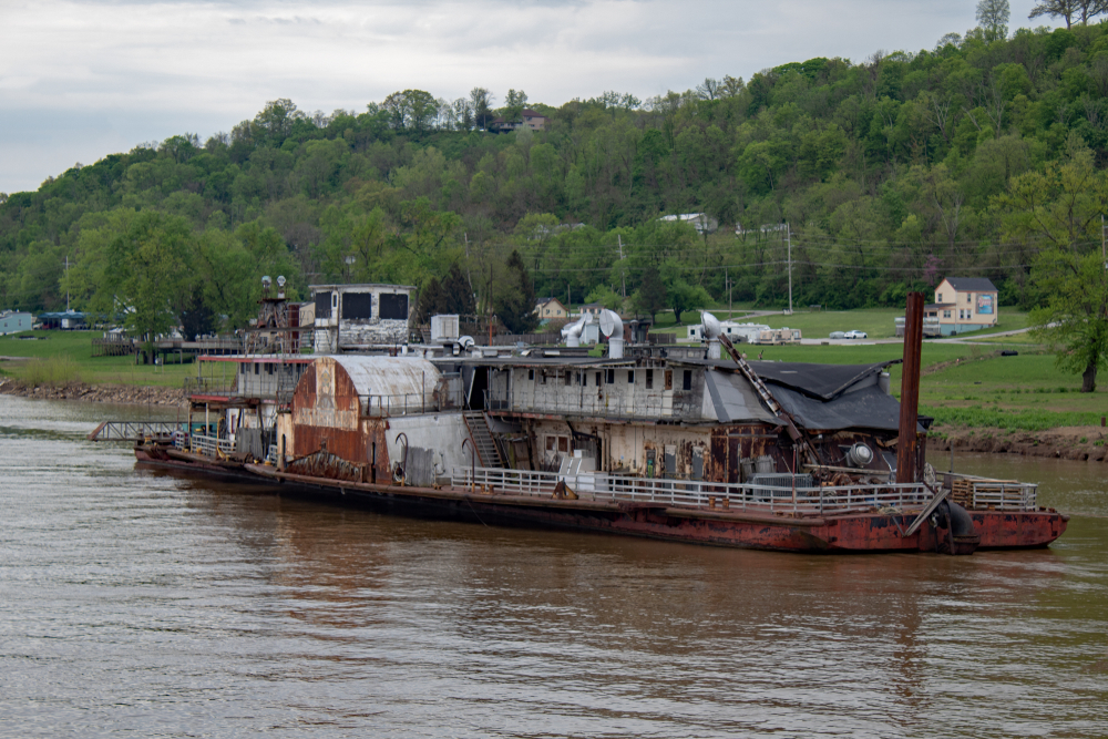 Rusting and dilapidated dredge boat on the Ohio River, one of the haunted places in Ohio.