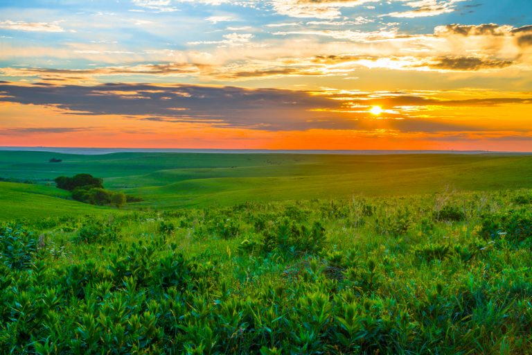 Gorgeous sunset over green hills of Flint Hills Kansas