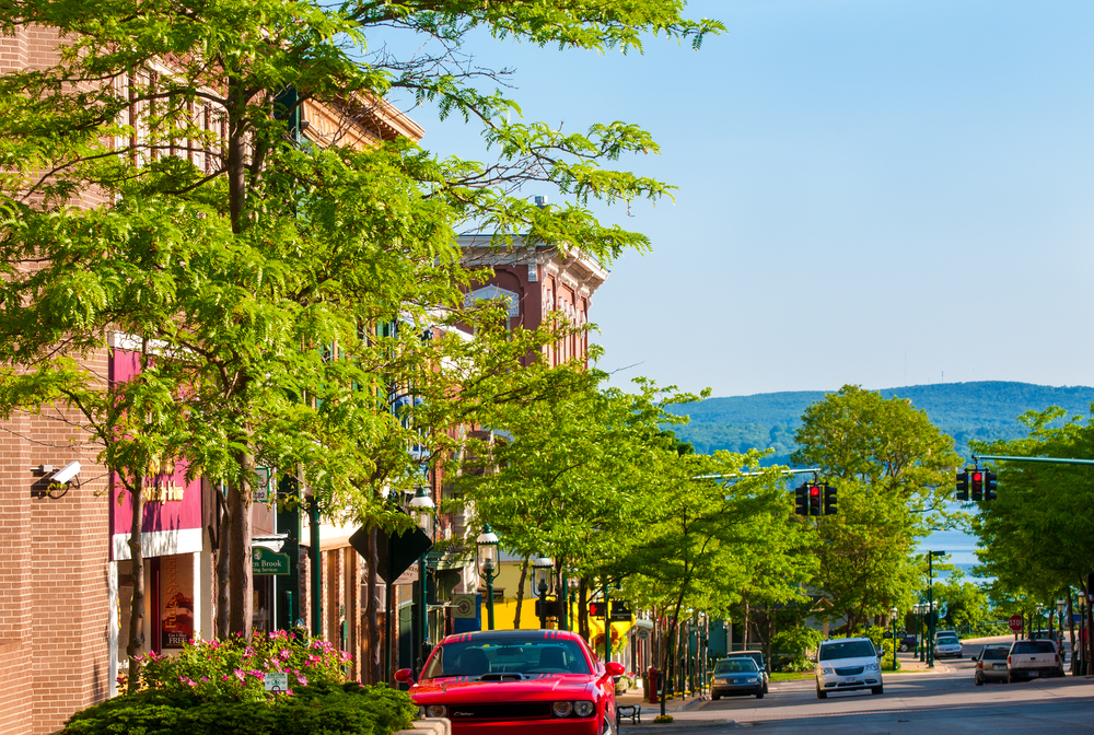 Vintage buildings of downtown with Michigan mountains in background.