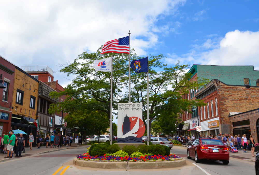 Downtown South Haven, small town  in Michigan, with flags waving and vintage buildings.