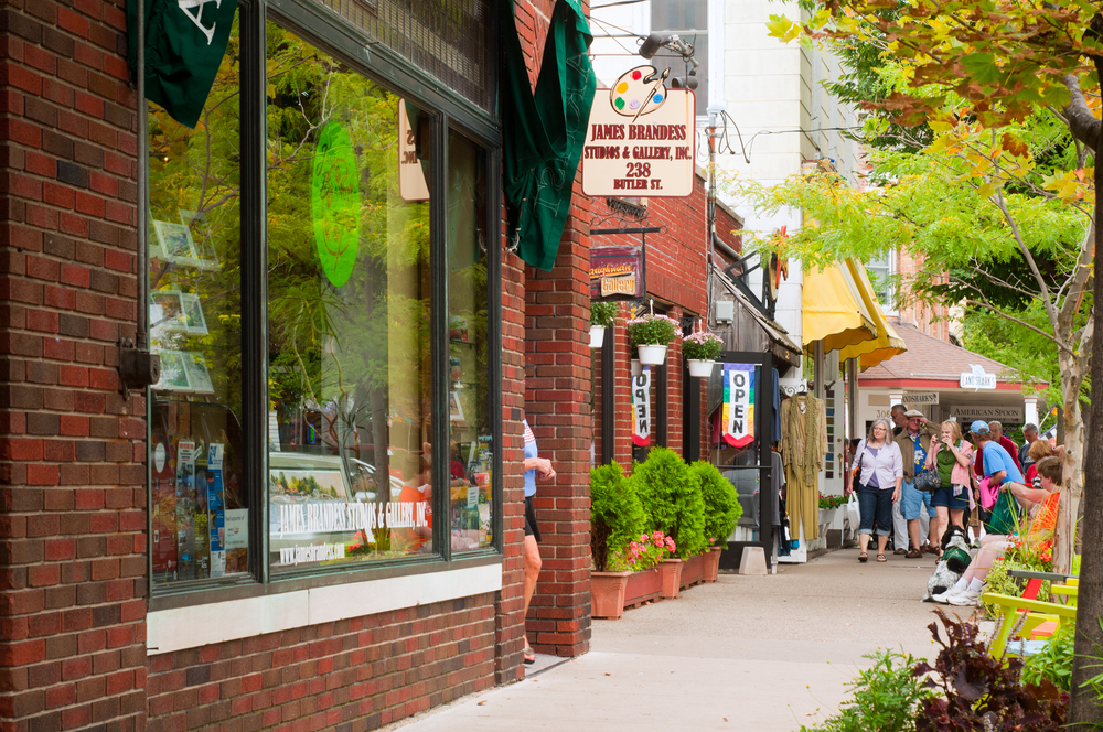 Vintage downtown shopping red brick buildings  in small town in Michigan.