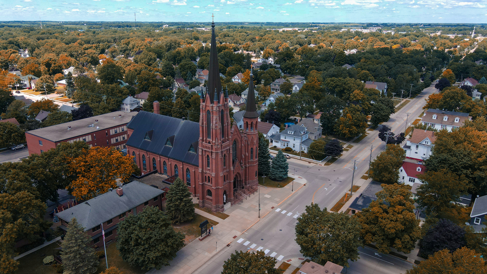 Aerial view of best town in Minnesota with Gothic cathedral in center