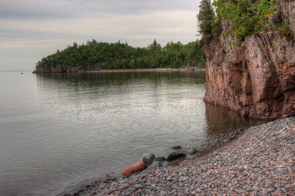 Rocky beach and shoreline along Lake Superior Minnesota small town.