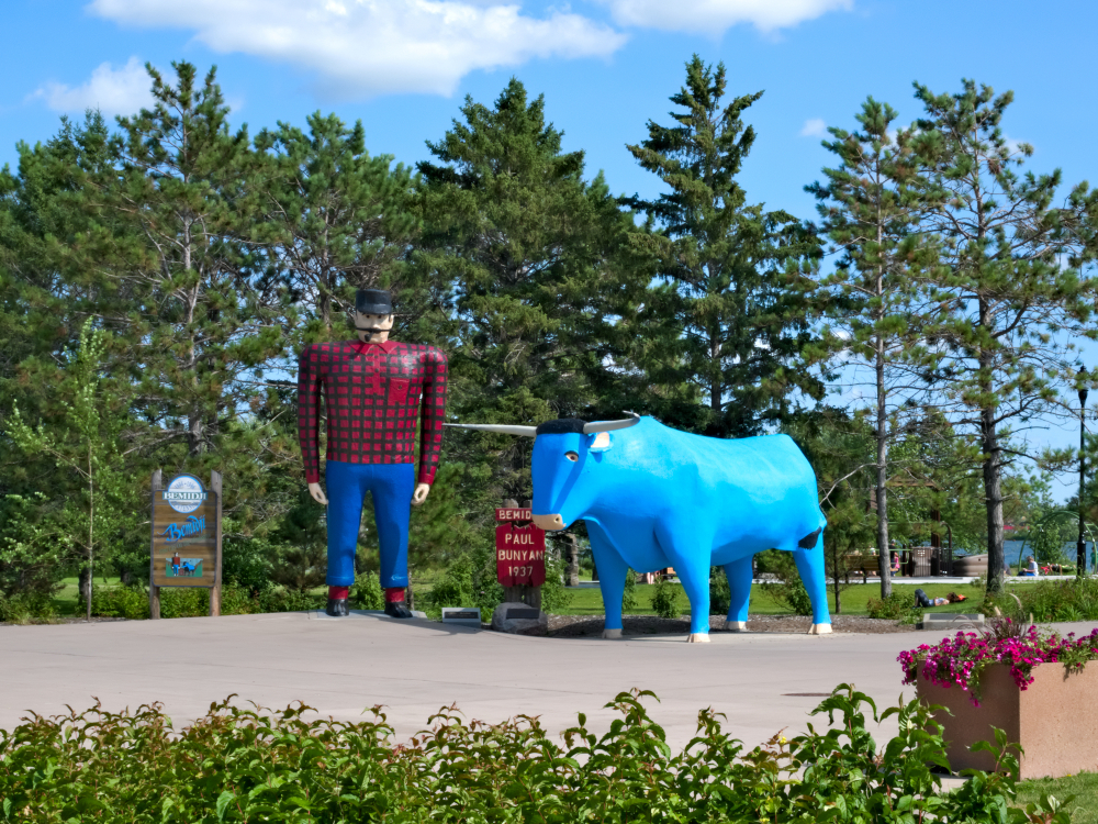 Oversize statues of Paul Bunyan and his blue ox small town Minnesota.