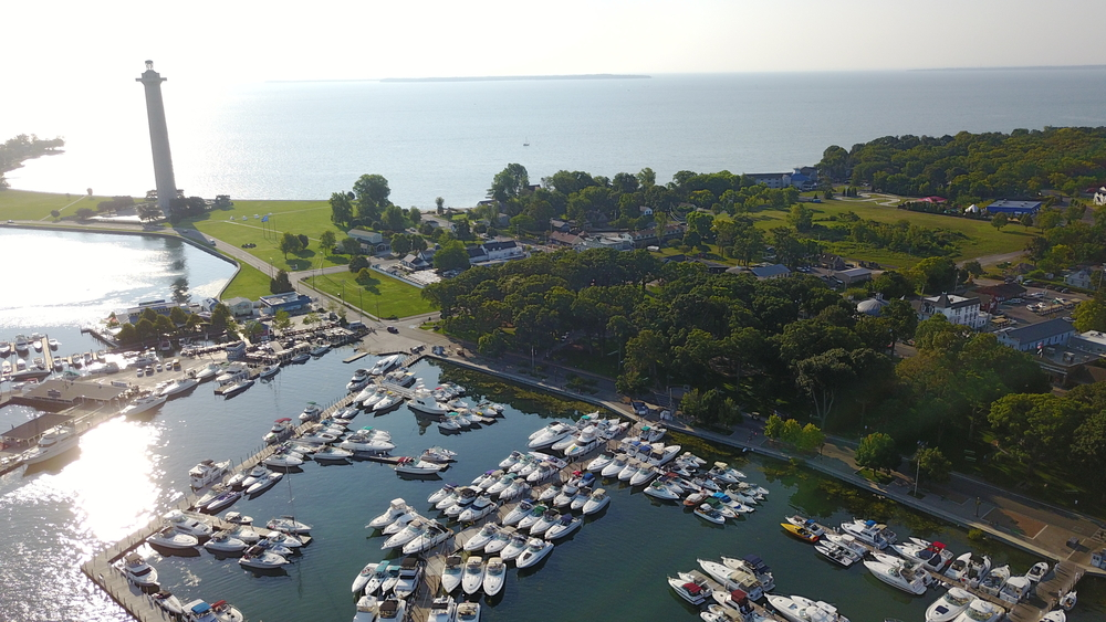 Overhead views of Put in Bay with marina, park and Perry Monument in the photo with Lake Erie in background.