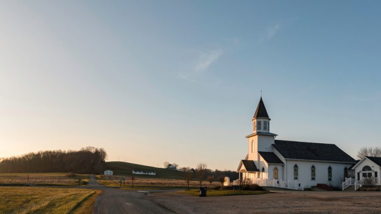 Rural white church with steeple in a small town Ohio, Glenford.