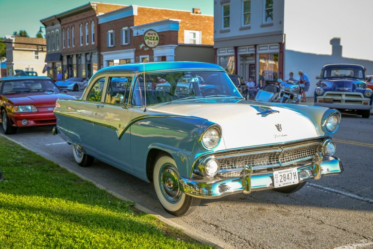Downtown of small town Ohio Milan, with vintage teal blue car in foreground.