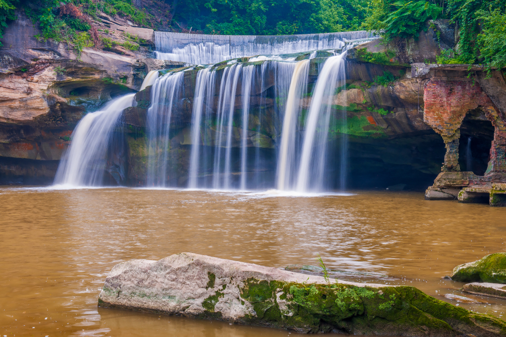 Ohio waterfalls are found everywhere. East Falls are urban waterfalls cascading over rocks into water below.