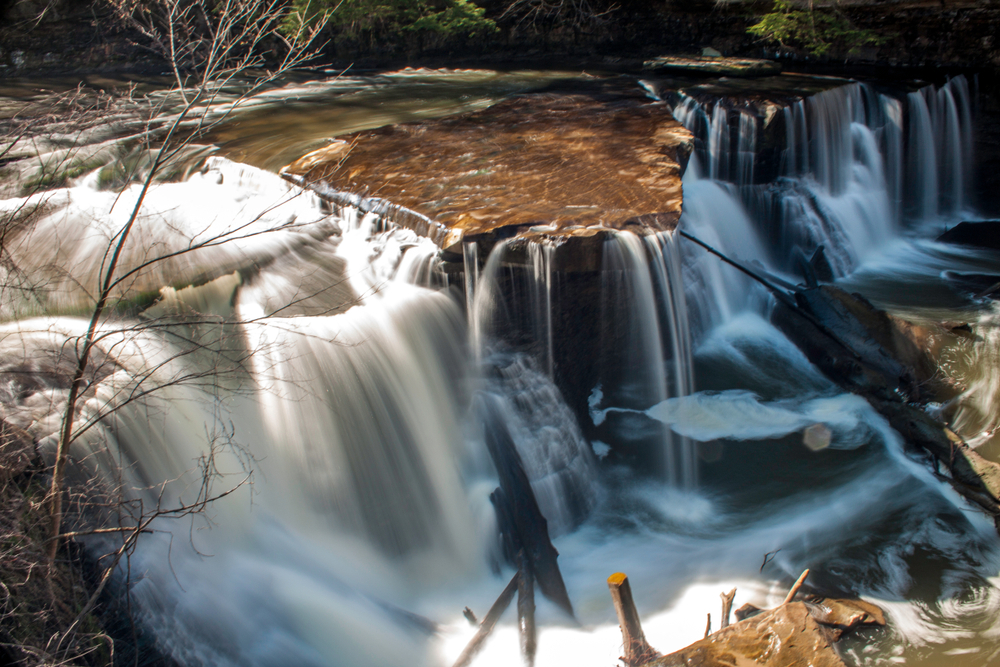Great Falls of Tinkers Creek in in Bedford Ohio with cascading water over rock formations.