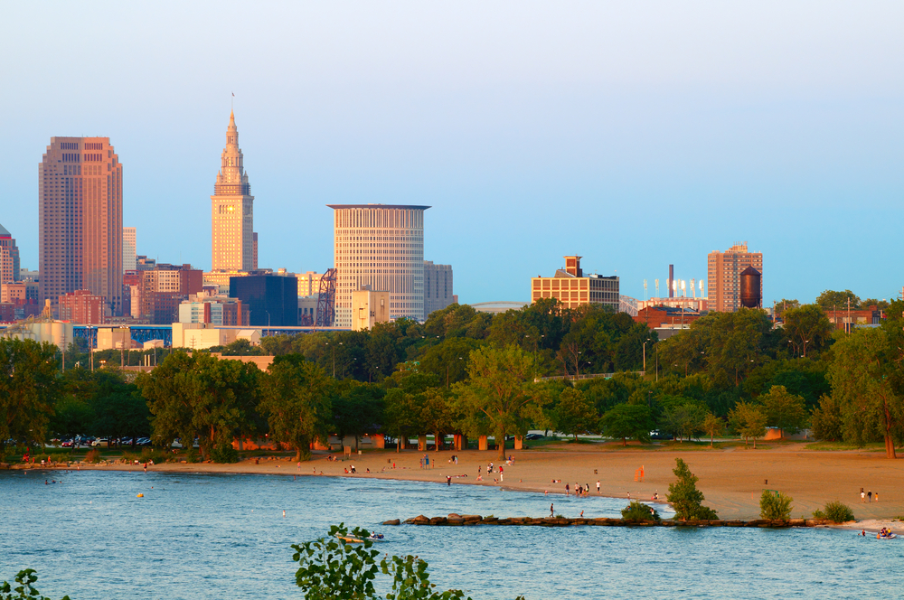 Sandy beach with Cleveland skyline behind it is one of the best Ohio beaches to visit.