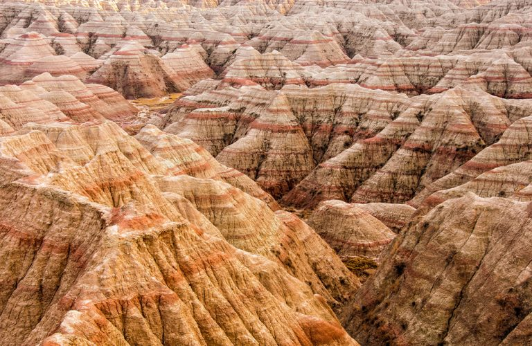 Peaks of multicolored rocks in Badlands Midwest national park.