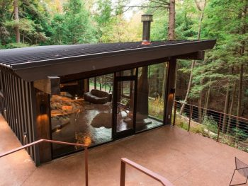Midwest Airbnb in Ohio modern glass cabin surrounded by trees