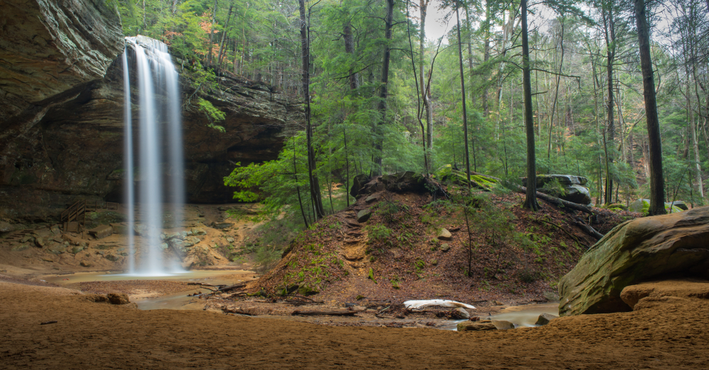 Visiting epic waterfalls like this one over the shale stones of Hocking Hills is one of the best things to do in Ohio.