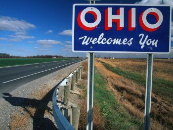 Blue Ohio Welcomes You sign alongside highway