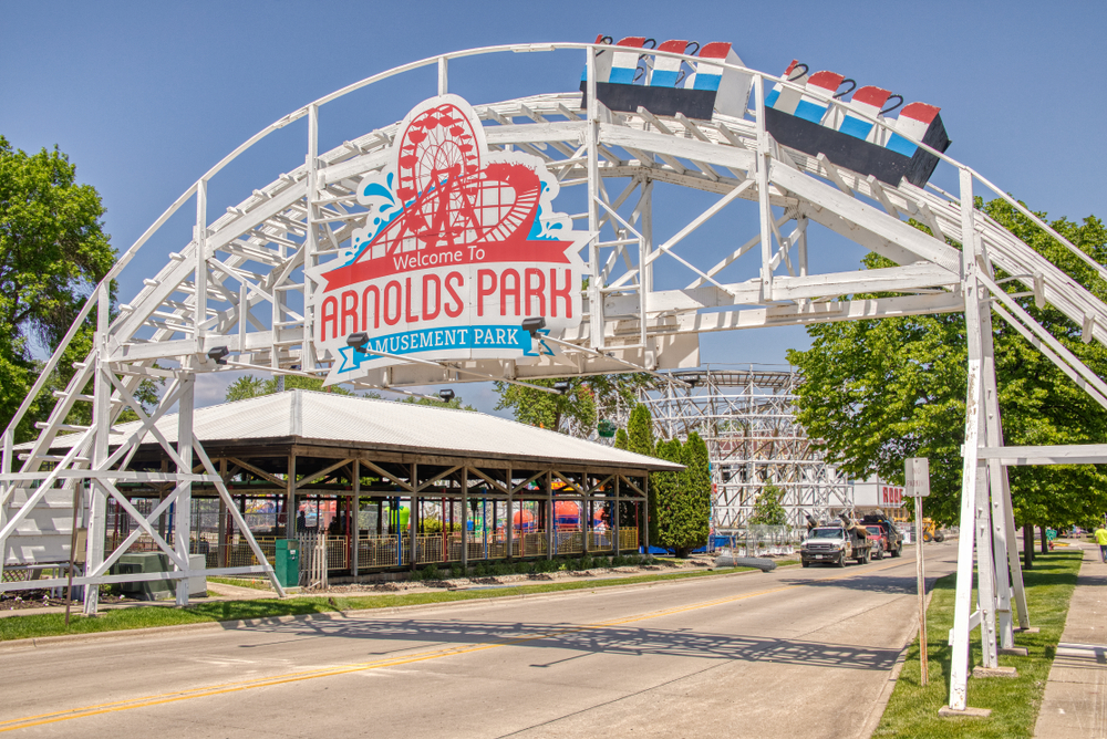 A white metal arch entrance to Arnolds park an amusement park in the midwest