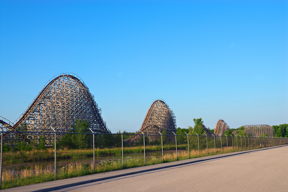 A up and down roller coaster viewed from the road in an article about amusements parks in the Midwest