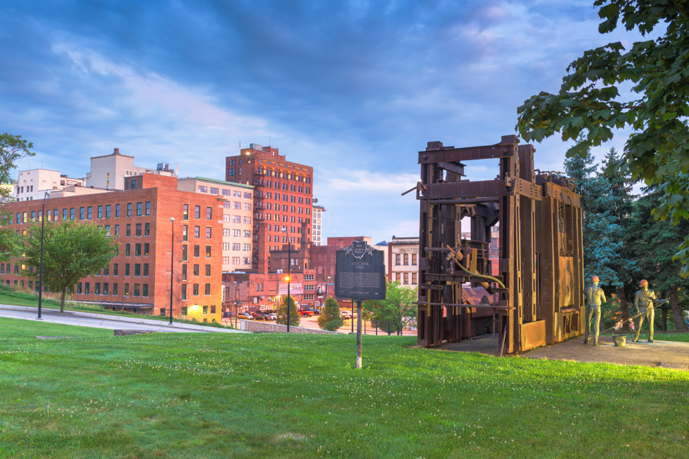 Little Steel Mill Workers Monument and Memorial with Youngstown Ohio downtown building in background.