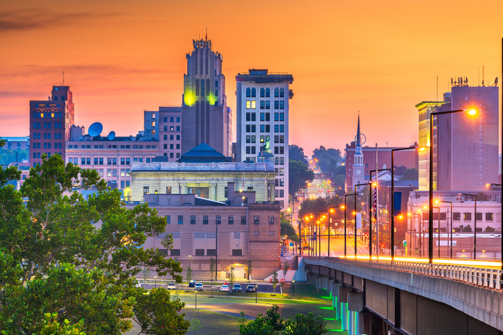 Twilight sets in on downtown Youngstown skyline with very orange sky.