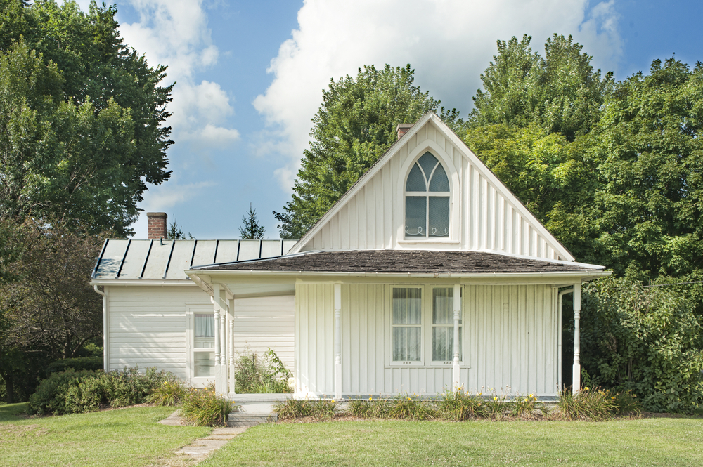 The original house that inspired the iconic painting 'American Gothic' in Iowa on a sunny summer day