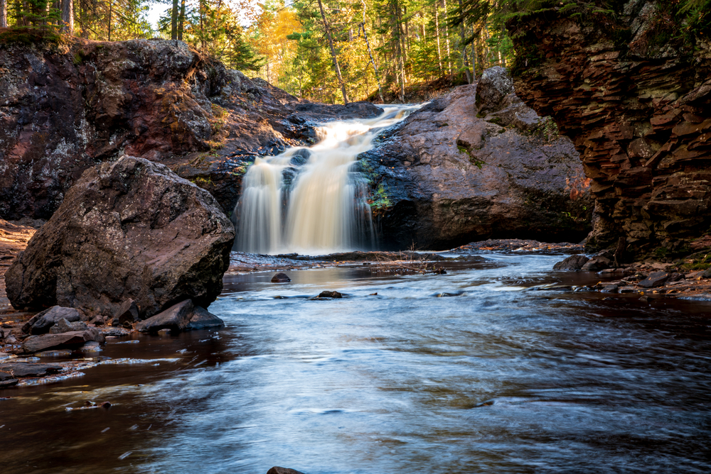 The waterfall at Amincon Falls State Park in Wisconsin on a sunny fall day