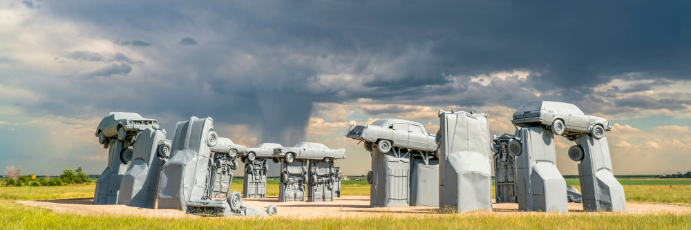 The Carhenge sculpture with a dramatic sky in the background in Nebraska