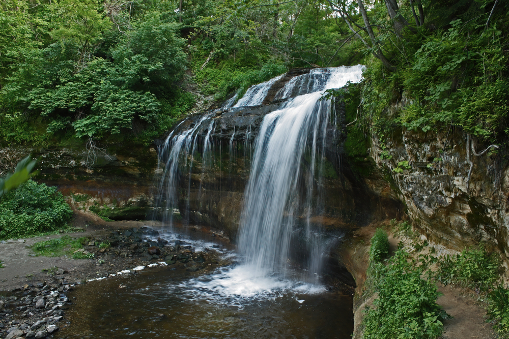 Cascade Falls surrounded by lush greenery one of the best waterfalls in Wisconsin