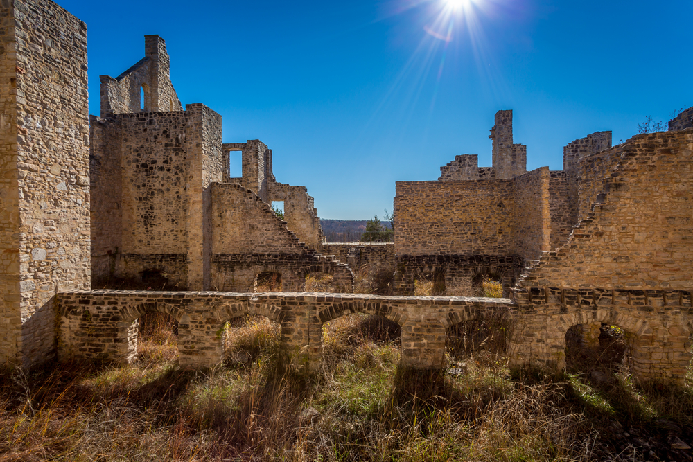 The Ha Ha Tonka Castle Ruins on a sunny day with the sun shinning directly on the ruins