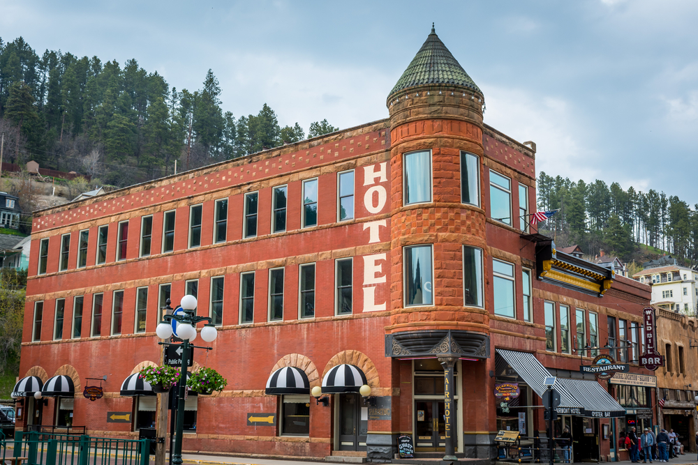 The red brick Historic Fairmount Hotel in South Dakota on a cloudy day Midwest road trips attraction