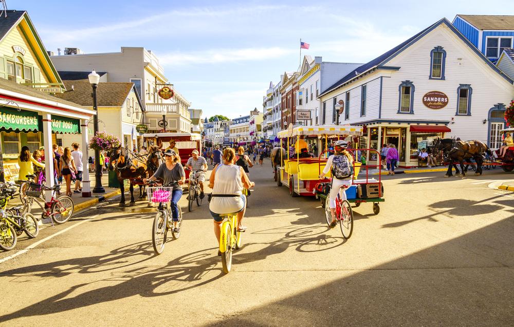 People biking on Mackinac Island in Michigan