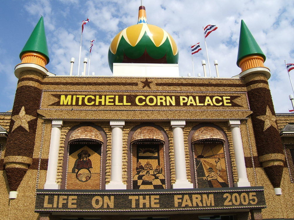 The exterior of the Mitchel Corn Palace on a sunny day with murals made of corn and other grains