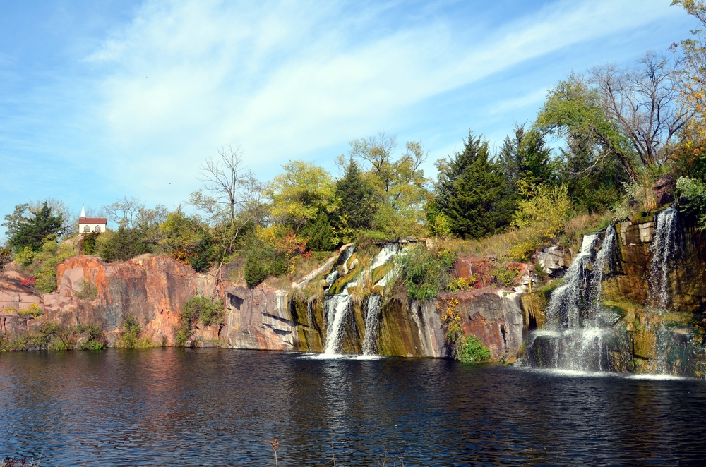 The unique Montello Granite Quarry Waterfall in the middle of downtown Montello on a sunny day