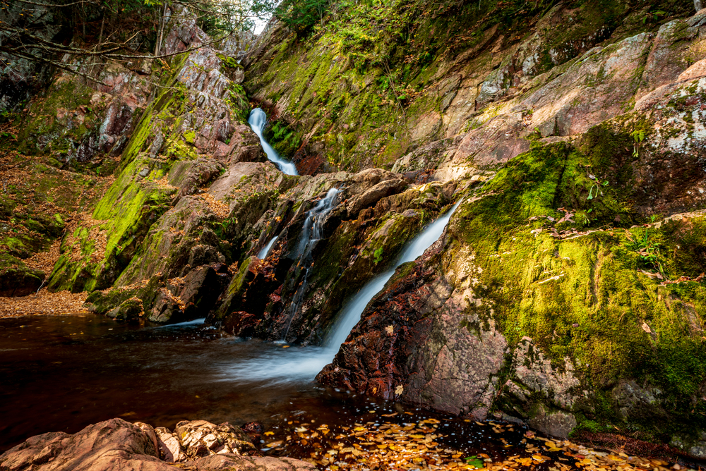 The skinny Morgan Falls in Wisconsin a waterfall that flows down a narrow groove in moss covered rocks