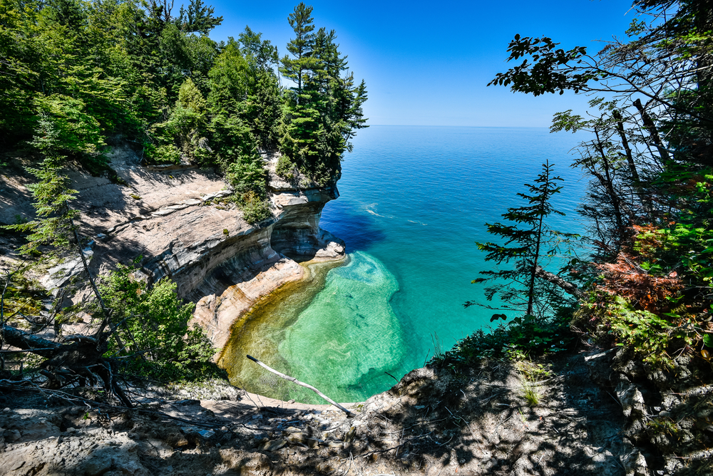 a cliffside at pictured rocks lakeshore weekend getaways in michigan