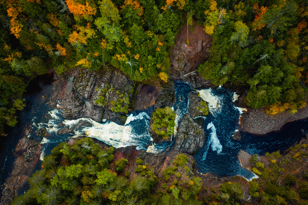 an aerial view of the Saxon Falls during the fall in Wisconsin