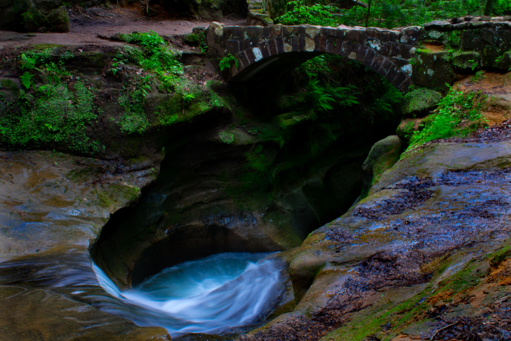 visiting this water swirling into gorge with greenery is one of the fun things to do in Ohio.