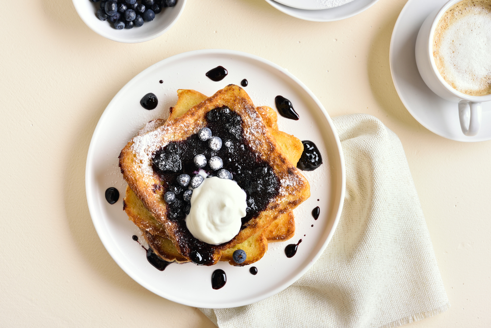 French toast with blueberries and cream on in an article about breakfast in Chicago