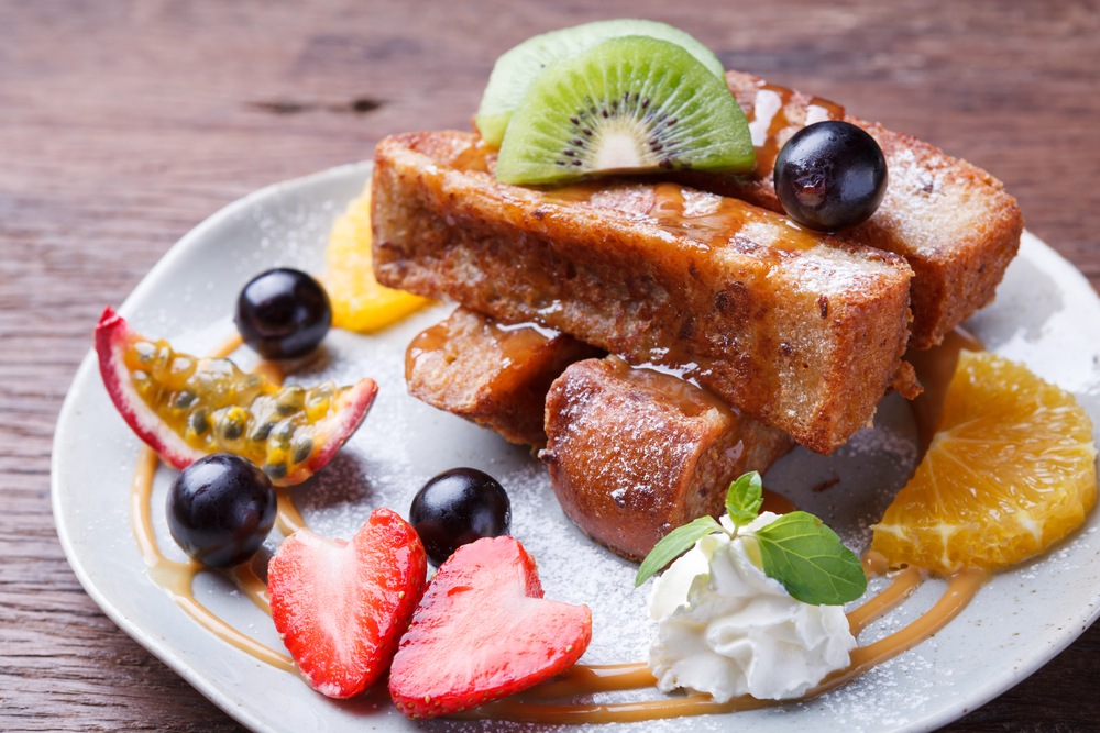 French toast on a plate with fresh fruit in an article about breakfast in Chicago