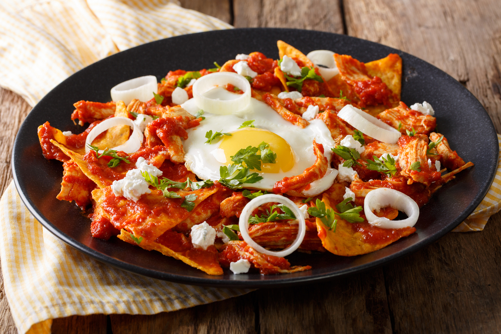 Nachos, tomato sauce and egg on a plate in an article about breakfast in Chicago