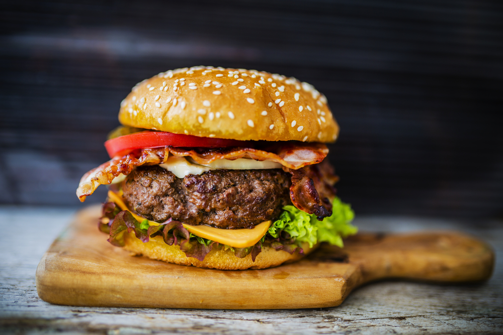 A juicy burger with bacon, cheese, lettuce, tomato restaurants in Cincinnati