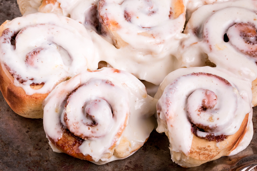 Cinnamon buns covered in icing