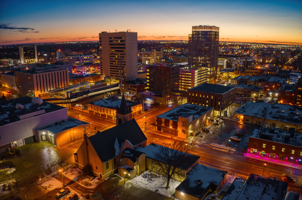 The city of Fargo at twilight with all of the buildings lit up