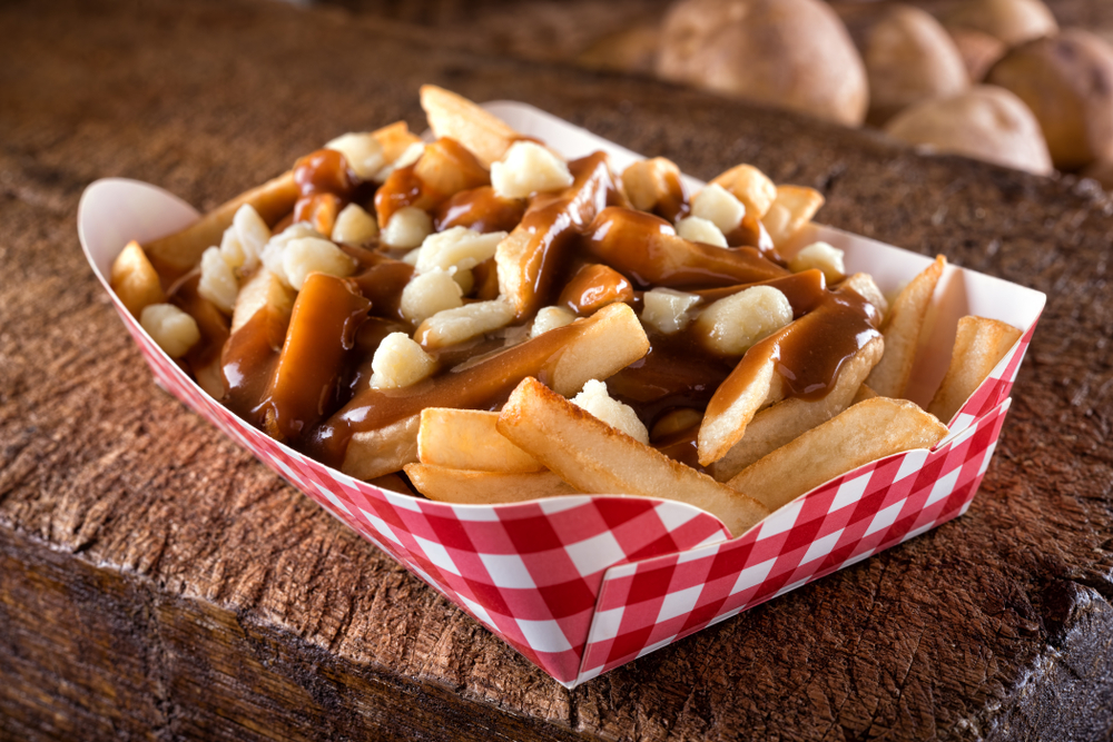 A tray of poutine fries which are french fries covered in gravy with cheese curds at one of the most unique restaurants in Cincinnati.