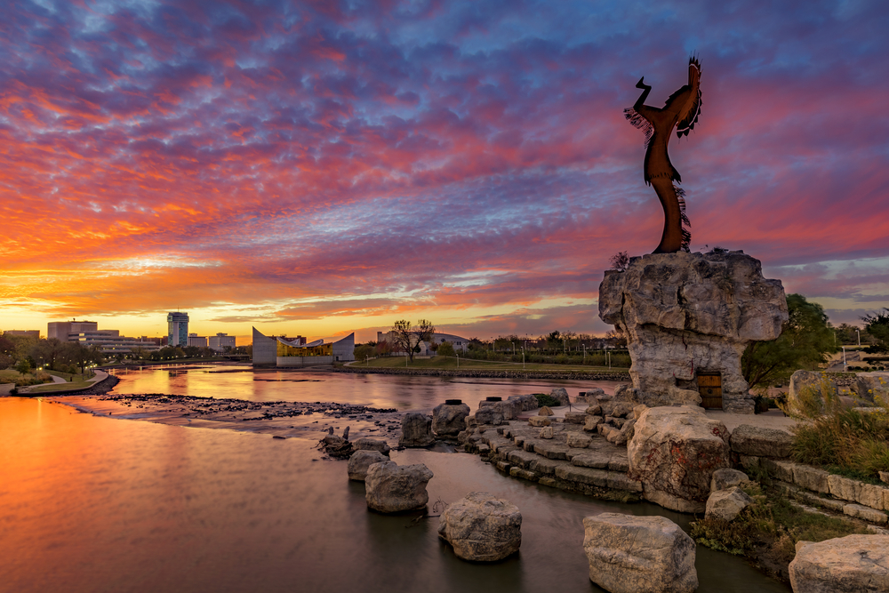 The Keeper of the plains overlooking the river at sunset this is one of the things to do in Kansas