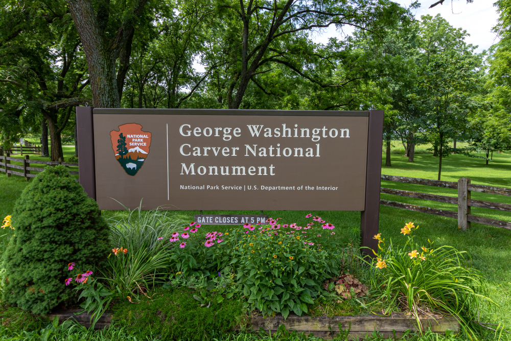 Brown sign of the George Washington Carver historic site with white letters. things to do in Missouri